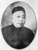 Born in 1868 in Suzhou, his father was a constable in Suzhou before the family migrated to Shanghai to open a teahouse. During his childhood, Huang contracted a bad case of smallpox. While his subordinates called him 'Grand Master Huang', behind his back everyone called him 'Pockmarked Huang'.<br/><br/>  Huang went to work at his father's teahouse, which was not very far from the Zhengjia Bridge near the French Concession. The bridge in those days sheltered a large population of hustlers and crooks. Huang Jinrong fitted right in, and organised many of them into a gang who later became his sworn followers. Aged 24, Huang passed the entrance exams and entered the French Concession police force, the Garde Municipale in 1892. Being strong, brash and capable, he did very well and became a detective in the Criminal Justice Section (Police Judiciaire).<br/><br/>  With the exception of a brief sojourn to Suzhou, Huang served continuously in the Police Judiciaire for twenty years until his retirement in 1925 after several major scandals rocked the department. Although associated with gangs such as the Big Eight Mob, his public profile was always aligned with the police.